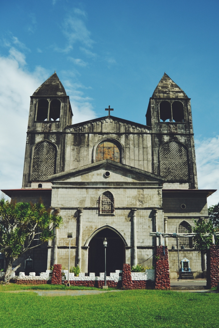 The imposing facade of the Santiago El Mayor Cathedral anchors Dapitan's city center.